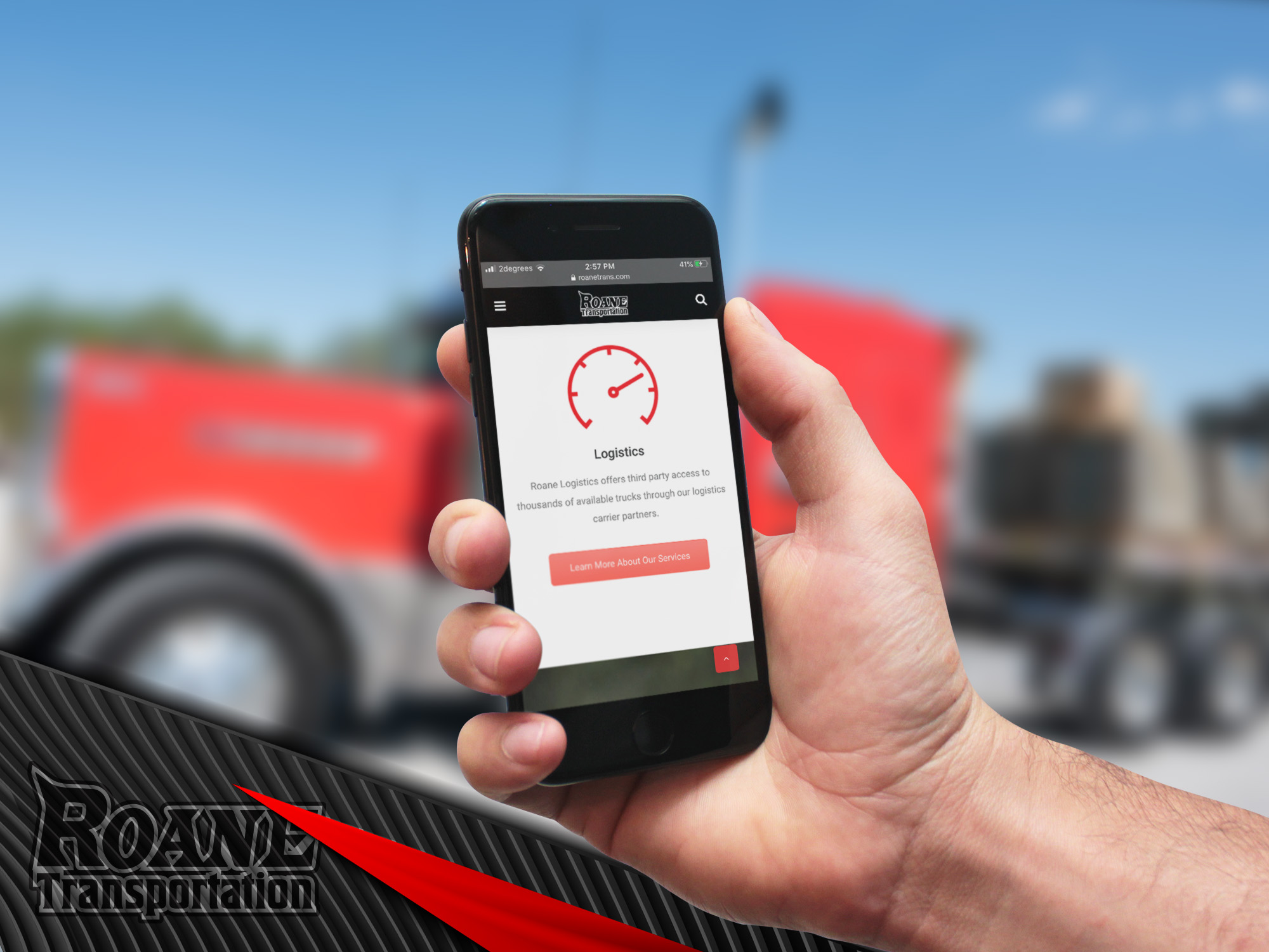 hand holding a cellphone with a trucking website displayed on the screen